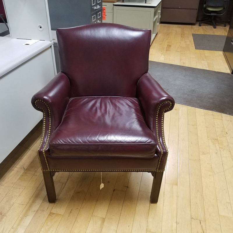 dark brown leather business chair with wooden legs