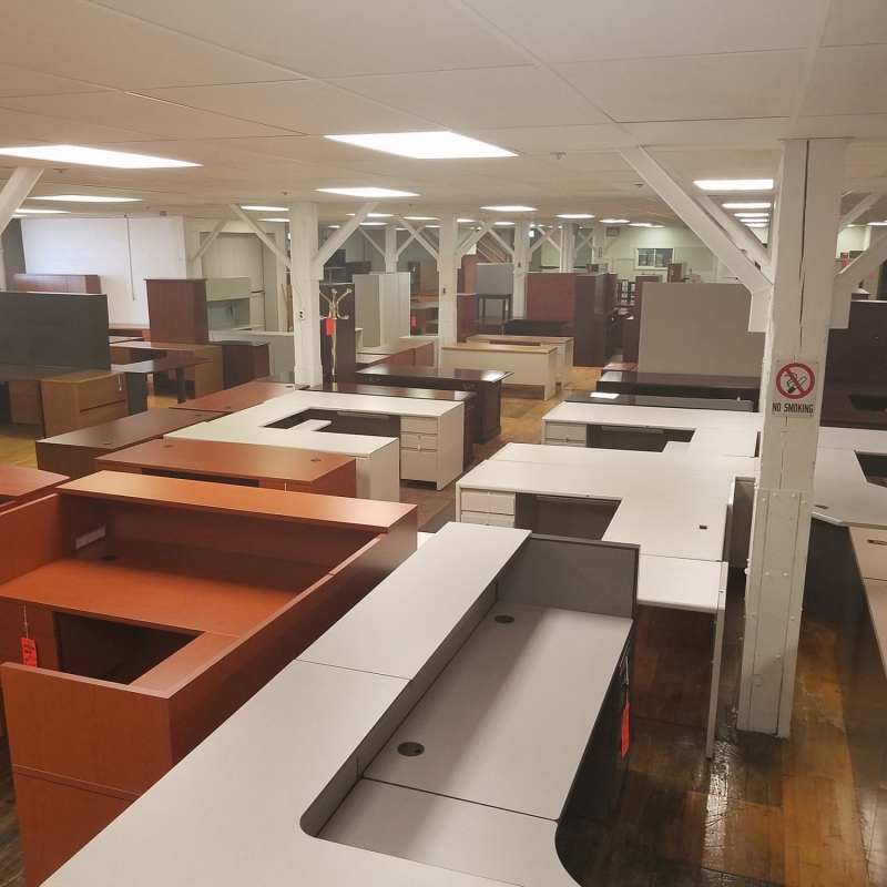 Overhead Shot showing the large inventory of many kinds of desks